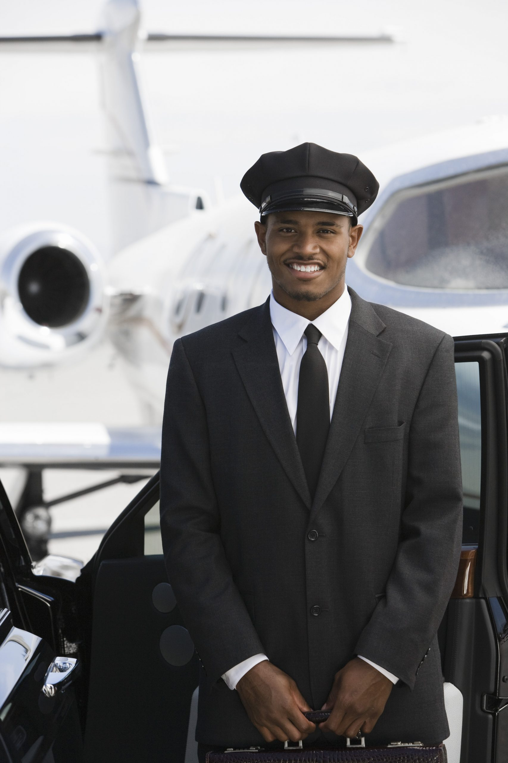 chauffeur in front of airplane